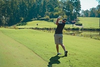 Keep your head still and look at the ball to hit golf ball straight